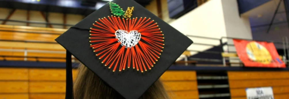 mortarboard with apple sewn on it at graduation