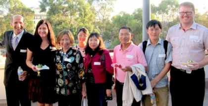 Faculty and international scholars at an event at the Gevirtz School