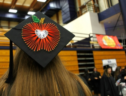 mortarboard with apple corcheted on it