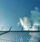barbed-wire fence and blue sky beyond