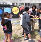 Ribbon cutting at Isla Vista mural